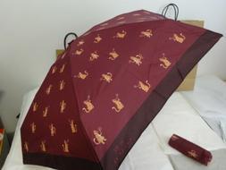 Coach Mini purse size umbrella. New w/ tags and gift box inc