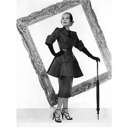 Zsa Zsa Gabor with umbrella poised ahead of frame 8 x 10 Inc
